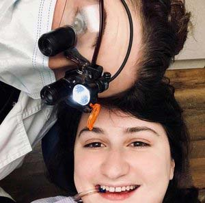 a woman dentist and a girl patient