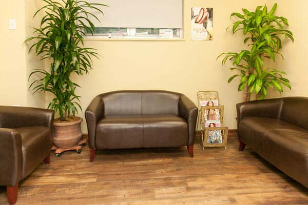 brown couch in dental clinic lobby